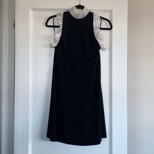 Leona Edminston black dress with white trim